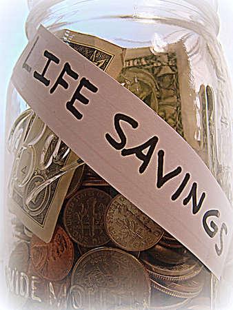 life metaphor: A life savings metaphor Stock Photo