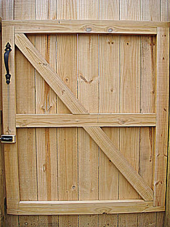 Wooden fence gate made of pine