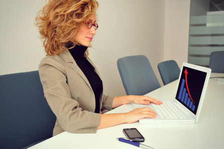 Businesswoman is working with Laptop photo