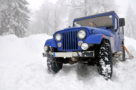 Offroad 4x4 in the snow  photo