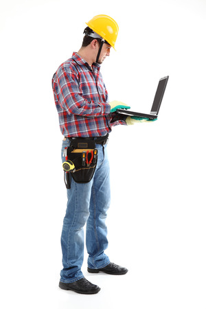 Construction Worker using Laptop on the white background  Isolated on white Stock Photo