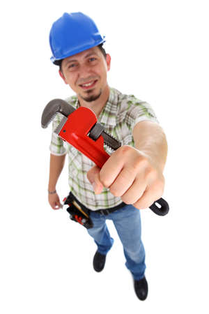 class maintenance: A plumber holding a red pipe wrench  Isolated on white  Stock Photo