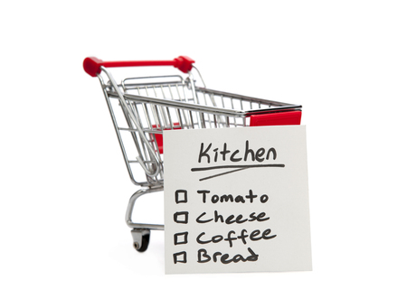 Shopping Cart and List on the white background photo