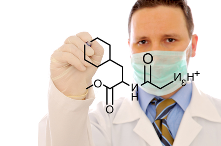 The doctor is writing a formula on the white background photo
