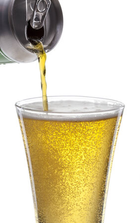 focus on beer glass. Pouring beer on the white background Stock Photo