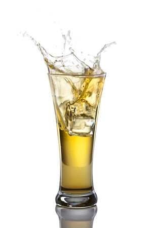Beer and froth splashing in beer glass isolated on white background. photo