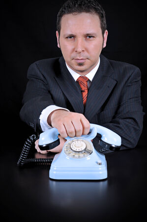 businessman waiting call: Businessman is waiting for Important call on the black background