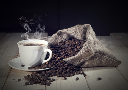 Coffee beans with coffee cup photo