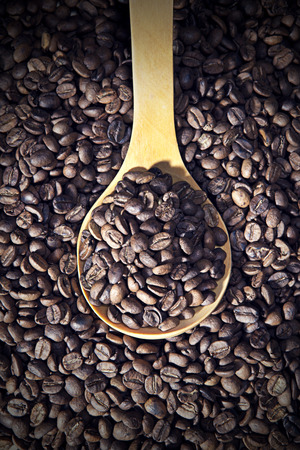 Coffee beans with spoon photo