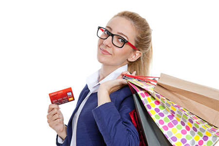 Businesswoman holding credit cards with shopping bags on white background photo