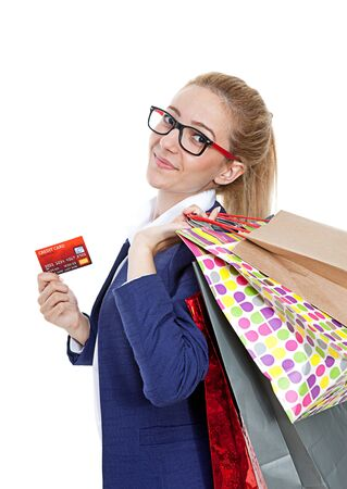 Businesswoman holding credit card with shopping bags on white background photo