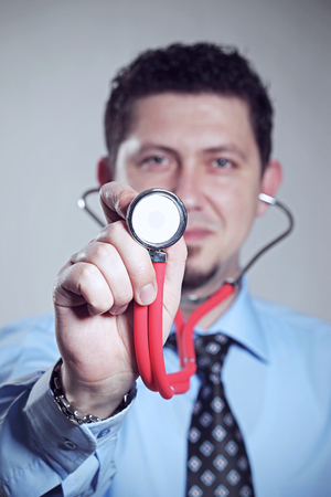 red stethoscope: doctor holding red stethoscope Stock Photo