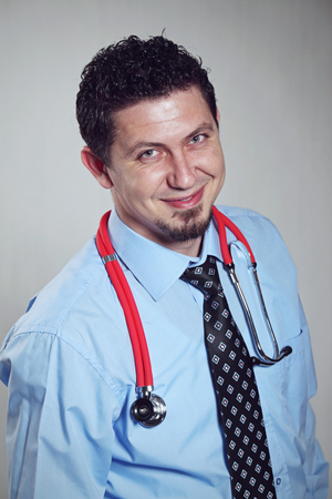 young male doctor: Portrait of handsome young male doctor smiling.