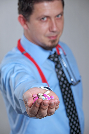 hand holding pills: Doctor Holding Pills in Hand