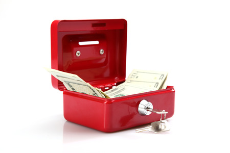 square shape: Currency in the money box on white background Stock Photo
