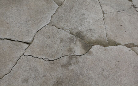 Old grey cement texture with cracks photo