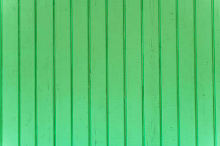 the surface of the wooden slats is painted green. Foto de archivo