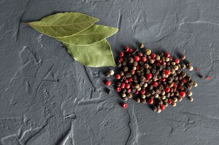bay leaf and pepper on a dark background