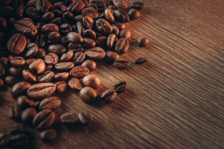 Coffee beans. Whole grains with aromatic spices, roasted coffee, blur.