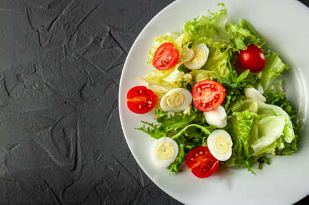 diet salad for weight loss and healthy eating, healthy lifestyle and right meals, salad with vegetables cherry tomatoes and quail eggs, Flat lay and top view. Empty space for writing text and inscriptions