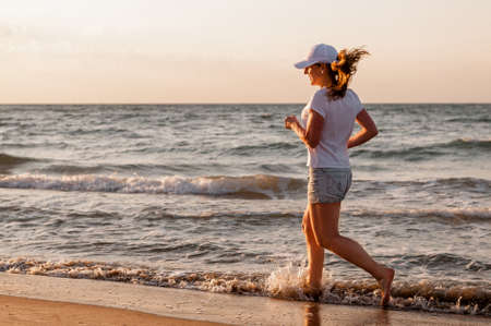 Athlete runs near the sea at dawn