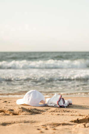 white clothes lying on the sand without people