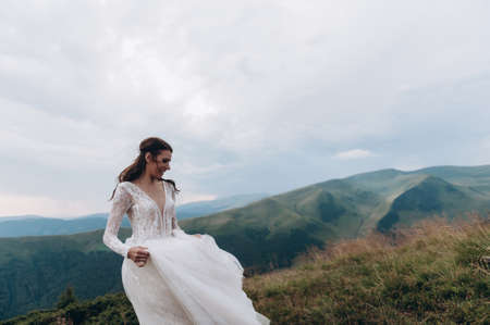 Bride in a white dress in the mountains