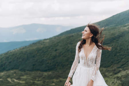 the bride is preparing to throw the bouquet. Bride in the mountains