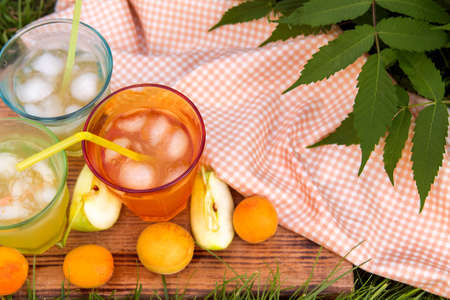 Homemade lemonade made with ripe peaches with ice