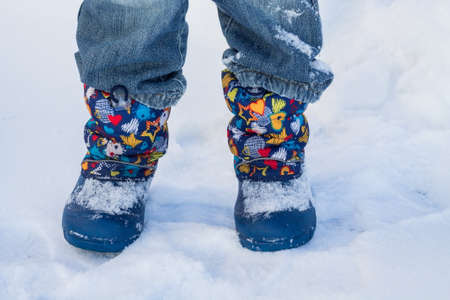 a winter walk through the snow in boots