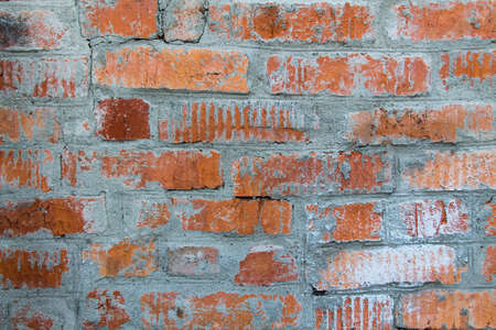 a very old wall or fence of brick