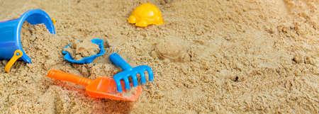child playing in the sandbox on a summer day Reklamní fotografie