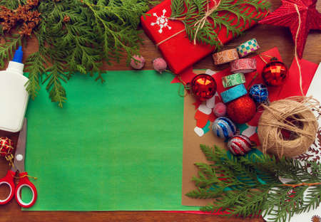 preparation for Christmas. The child makes a paper card, packaging gifts. Фото со стока