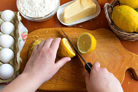 cooking homemade lemon cupcake with zest