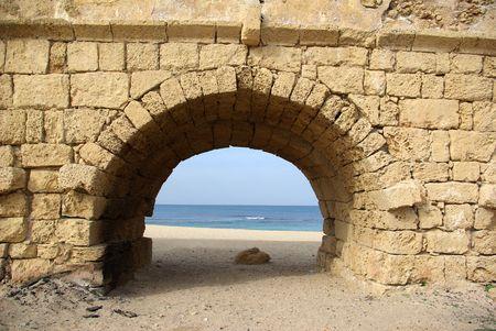 Ancient Roman aqueduct at Ceasarea along the coast of the Mediterranean Sea, Israel photo