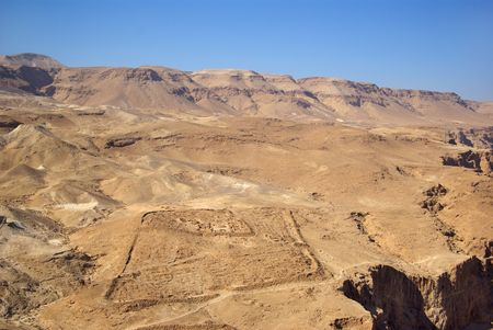 semite: View on roman fortifications and Judean desert from Masada fortress, Israel Stock Photo