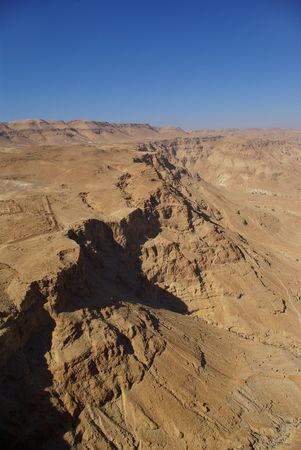 View on Judean desert and Roman fortification ruins from Masada fortress, Israel photo