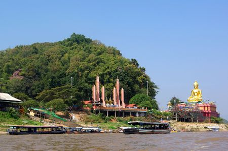 Giant statue of Buddha on river Mekong in the place named Golden Triangle