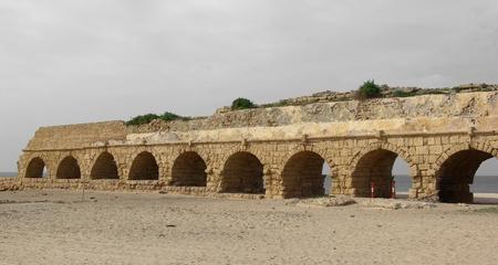 ceasarea: Ancient Roman aqueduct at Ceasarea along the coast of the Mediterranean Sea, Israel Stock Photo