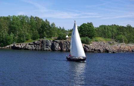 Sailing by Suomenlinna - island in Baltic sea near Helsinki. Finland photo