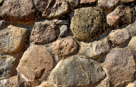 Texture of granite stone wall; background  photo