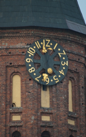 immanuel: Tower clock of Cathedral of Immanuel Kant in Kaliningrad, Russia Stock Photo