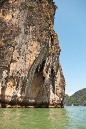 Wall of limestone island in Andaman sea, Thailand photo