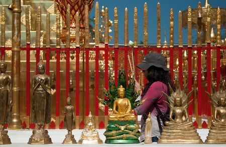 Buddhist prayer in the Doi Sutep Temple in Chiang Mai,Thailand