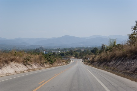 Road between mountains on the north of Thailand photo