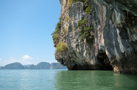 Under the wall of limestone island in Andaman sea near Phuket, Thailand photo