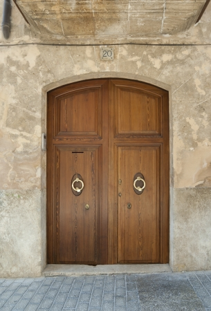 dilapidation: Wooden door of old stone house, Spain Stock Photo