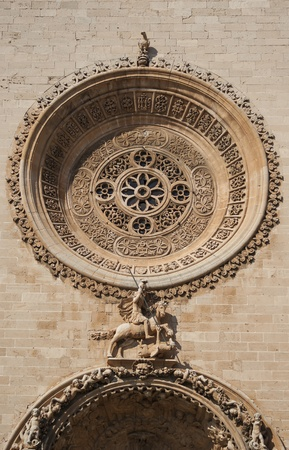 Saint George and the dragon - architectural detail at the facade of  Palma de Mallorca cathedral, Spain photo