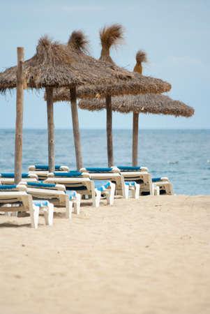 majorca: Beach umbrellas on the coast of Mediterranean sea, Mallorca, Spain