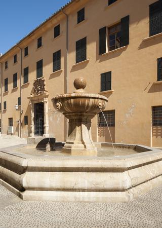 Old stony fountain in Palma de Mallorca, Spain photo
